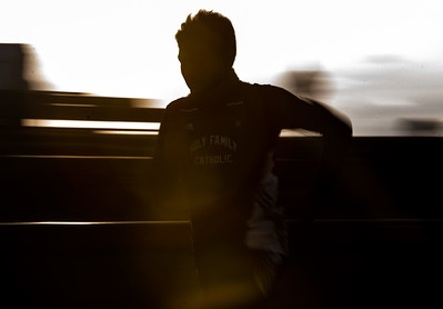 Gavin Frye participates in the 400m dash at a Track & Field Quadrangular Meet.