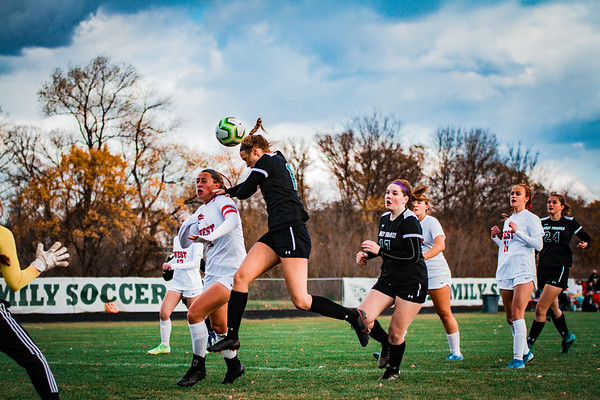 Holy Family Junior Maeve Kelly '22 goes up for a header in the section quarterfinal versus Mankato West High School.