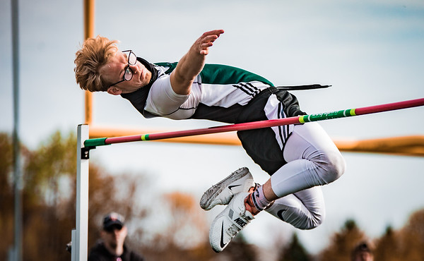 Jakob Lenzmeier participates in the High Jump at a Track Meet at Holy Family Catholic High School on April 30, 2021