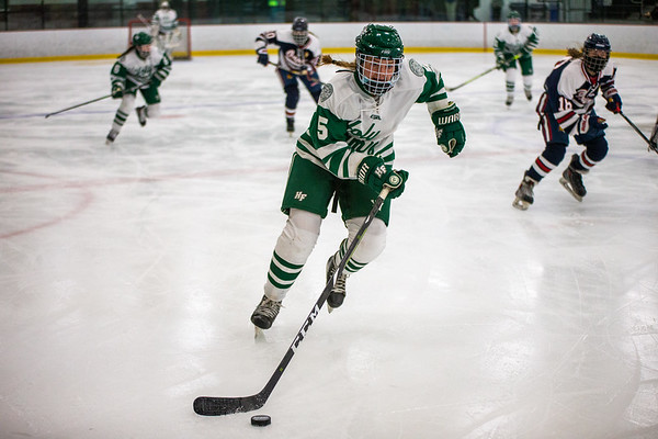 Briar Charchenko skates the puck up through the neutral zone during a game against Orono on January 19, 2021