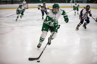 Briar Charchenko skates the puck up through the neutral zone.