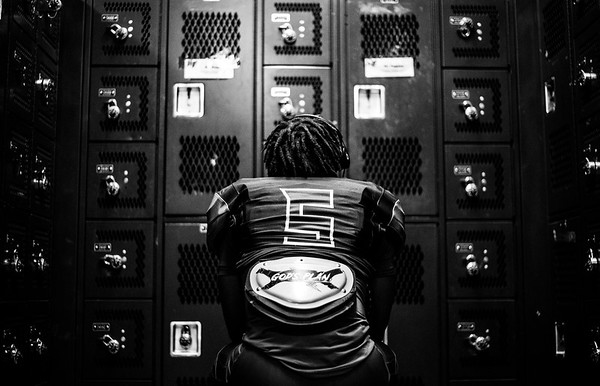 DJ Pegues (5) listens to music before Holy Family's last home football game of the 2020 season.