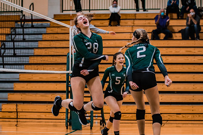 Holy Family Junior Emma Schuele '22 celebrates after gaining a point for her volleyball team.