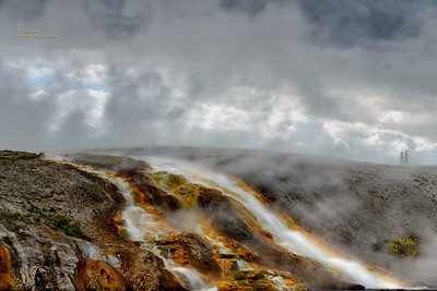 Hot Mineral Water Flowing from a Geyser Above