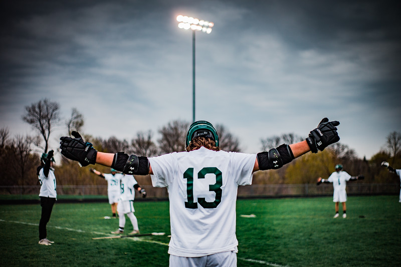 Jack Lund (13) warms up before a lacrosse game versus Saint Louis Park on April 26, 2021