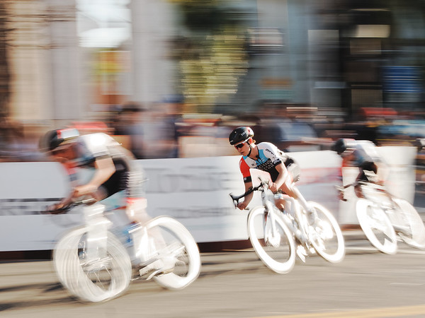Hagens Berman Axeon's Cole Davis takes a fast turn in the Redlands Stage 4 Crit, 2019.