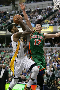 Paul George drives to the basket and it fouled by Jeremy Lin. 3-17-12 (Jeff Brown)