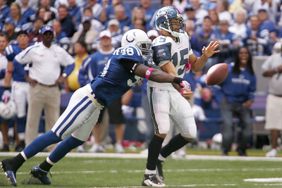 Robert Mathis strips the ball from Seattle quaterback Seneca Wallace.