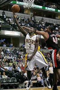 Pacer Darren Collison drives through the Portland defense for the bucket. 3-13-12 (Jeff Brown)