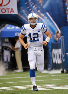 Andrew Luck sprints on to the field as the Colts open their pre-season against the Buffalo Bills at Lucus Oil Stadium August 11, 2013. {Flyer Photo/Jeff Brown}
