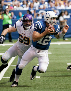 Andrew Luck looks downfield while under pressure from Vikings Jared Allen. (Jeff Brown/Flyer Photo)