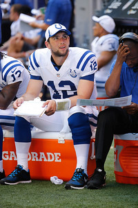Andrew Luck spends some time with the clipboard during the first pre-season game with the Buffalo Bills at Lucus Oil Stadium August 11, 2013. {Flyer Photo/Jeff Brown}