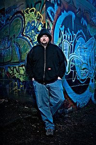 Steve, a local Salem artist poses for his portrait at a graffiti wall in South Salem, Oregon