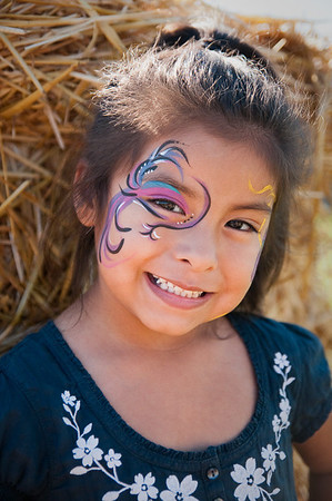 Face paint makes a portraits fun for kids.