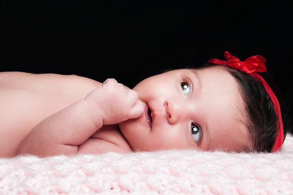 Two month old Juliana poses for a Valentines day portrait.