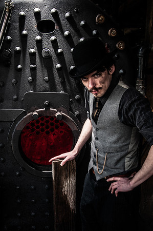 Dark and dirty portrait of a man at a Boiler in Brooks, Oregon