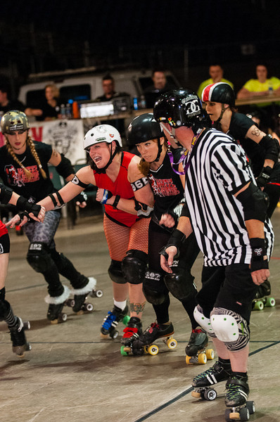 A derby girl gets a good hit on 8 Wheel Assasian's Jammer at the Pavallion in Salem, Oregon