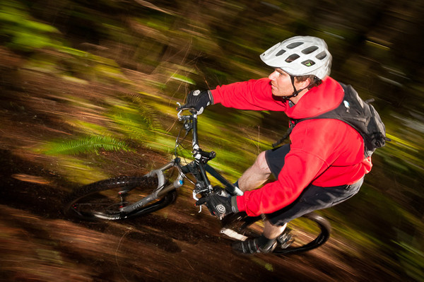 Sean flying down the trail on his mountain bike at a secret location in the Cascade Mountains.