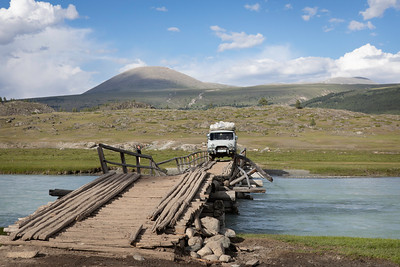 Crossing a collapsed wooden bridge, Mongolia