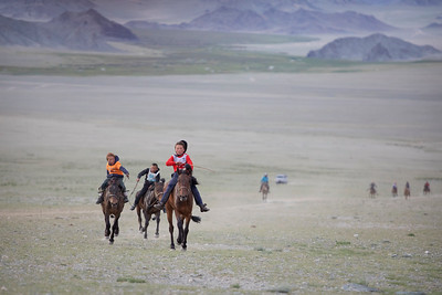 Horse racing at the naadam at Tsengal, Mongolia