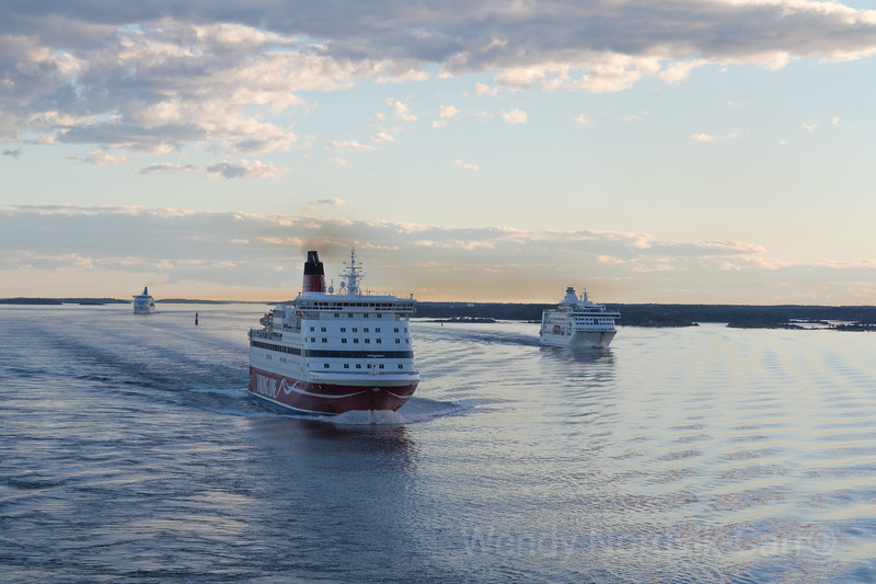 Cruise ships in the Baltic Sea during sunset sail through the islands from Sweden to Germany