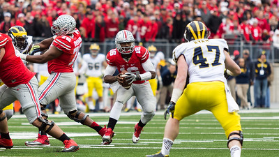 Ohio State Buckeys Quarterback JT Barrett (16) looks for an open man