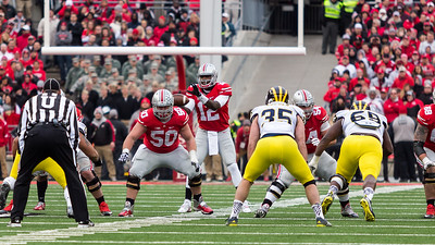 Ohio State Buckeys Quarterback Cardale Jones (12) takes a snap