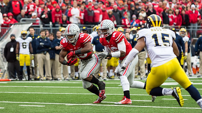 Ohio State Buckeys Quarterback JT Barrett (16) hands off to Running Back Ezekiel Elliott (15). Ohio State went on to beat Michigan 42-28