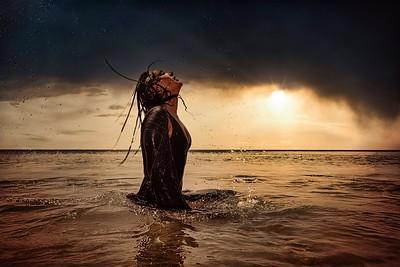 Model in ocean sunset