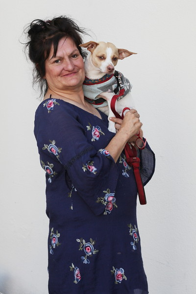 A woman and her dog in bridge housing thanks to Stories FromThe Fronline.