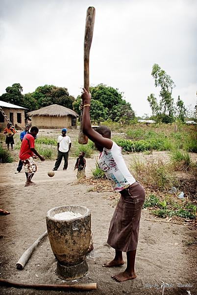 Woman making nsima in Malawian countryside village.