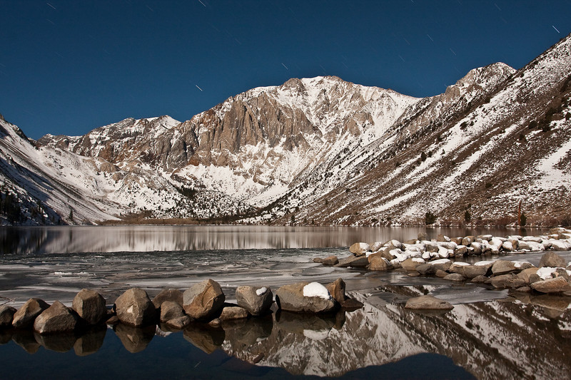 Convict Lake and the Sevenhah Cliffs under a bright winter full moon in the Eastern Sierras, Mammoth, California