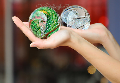 """""""Two Worlds In Two Hands""""  glass balls being modeled for a cutstomer, kinda like the shape of her hands..Manitou Springs, Colo"""