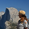 Yosemite National Park... female park ranger in profile...monolith, Half Dome miles away in background.