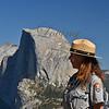Yosemite National Park... female park ranger in profile...monolith, Half Dome miles away in background.