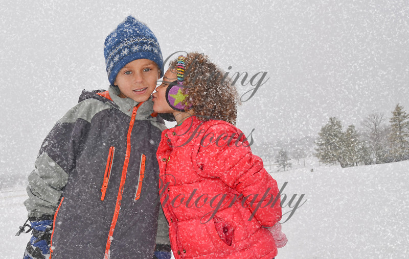 Siblings in the Snow ... kiss me quick.