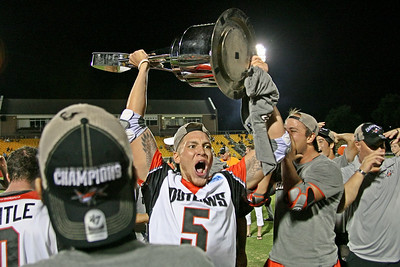 Denver Outlaws Josh Hawkins hoists the Steinfeld Cup after beating the Dallas Rattlers 16-12 to win the 2018 Major League Lacrosse Championship.  Hawkins announced his retirement not long after the victory.  August 18, 2018, MUSC Health Stadium, Charleston, SC