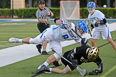 Tampa Jesuit is penalized for a crosscheck while trying to ride Bishop Moore out of bounds during a Florida State playoff quarterfinal game which Bishop Moore won 8-5.  May 4, 2018, Jesuit High School, Tampa, FL