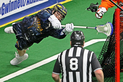 Georgia Swarm forward Shayne Bennett attempts a front dive back flip during a 16-12 victory on Opening Weekend 2019.  The Swarm wore special Star Wars uniforms which were auctioned off to fans.  December 15, 2018, Infinite Energy Arena, Duluth, GA