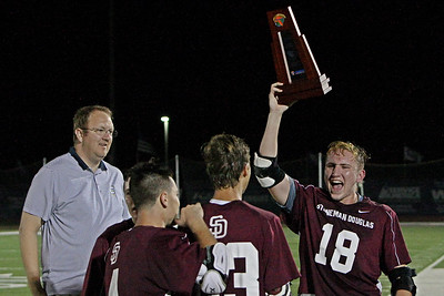 The Stoneman Douglas Eagles needed overtime to get it done, but they beat Pine Crest 10-9 to win the Section 27 Championship.  Team Captain Jack Haimowitz hoists the trophy as he celebrates with his co-captains.  April 19, 2018, Calvary Christian Academy, Ft. Lauderdale, FL