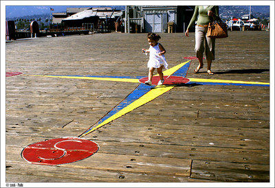 Bianca running over compass drawn on Santa Barbara's Wharf