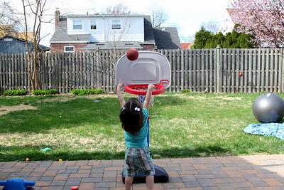 Shooting hoops in the backyard.