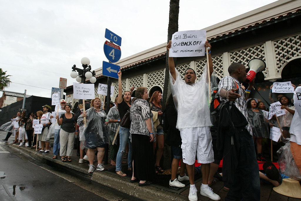 Protesters surround the Columbia restaurant in the Ybor City district of Tampa, Florida.  Moving around in tour buses, the protesters had stopped at Hancock Bank near International Plaza and then made their way to Ybor City where political fundraising dinners were being held.  August 27th, 2012.