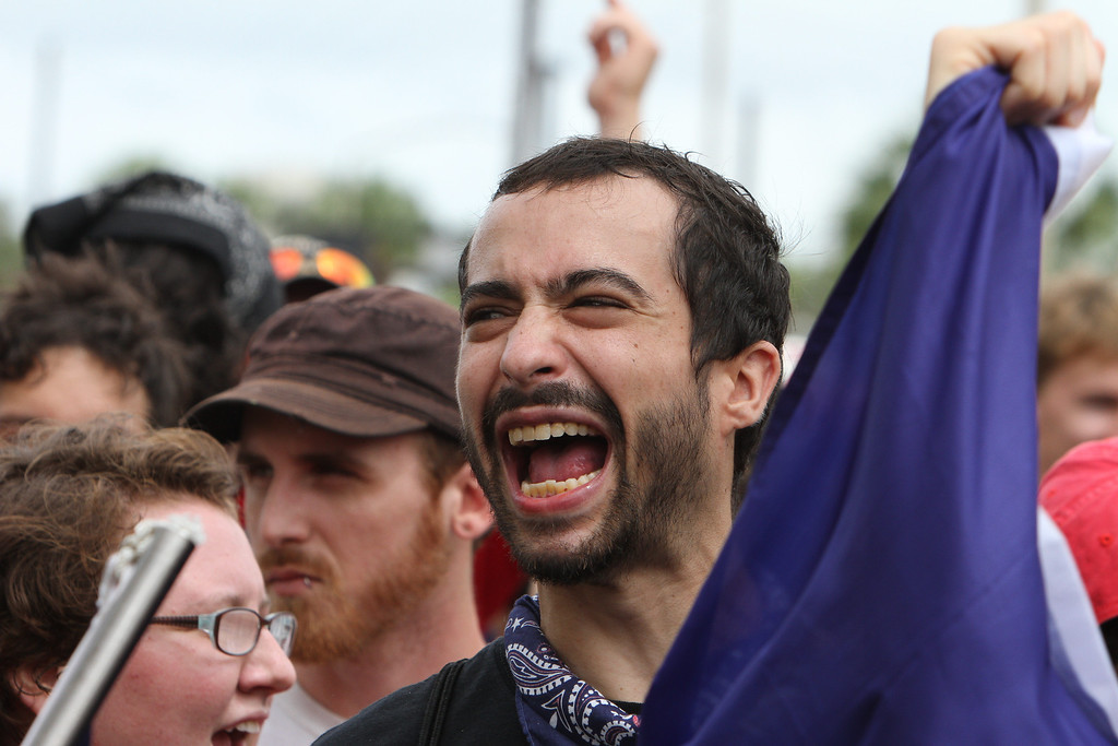 A protester shouts a chant as the Coalition March on the RNC makes its way through the streets of downtown Tampa, Florida on August 27th, 2012.