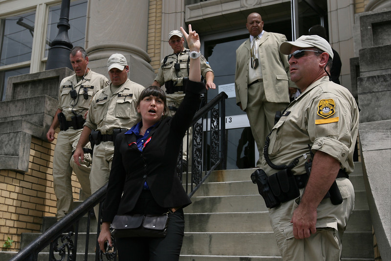 Code Pink co-director Rae Abileah is escorted from the Centro Asturiano building by police  after interrupting Condoleeza Rice's speaking engagment inside.  August 29th, 2012.  Tampa, Florida.