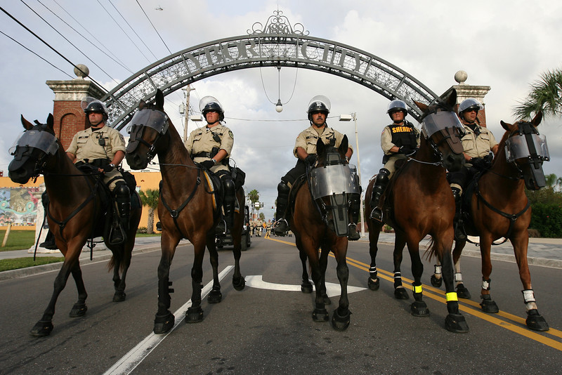 Mounted police officers follow a group of Republican National Convention protesters marching through the Ybor City district of Tampa, Florida.  August 28th, 2012.