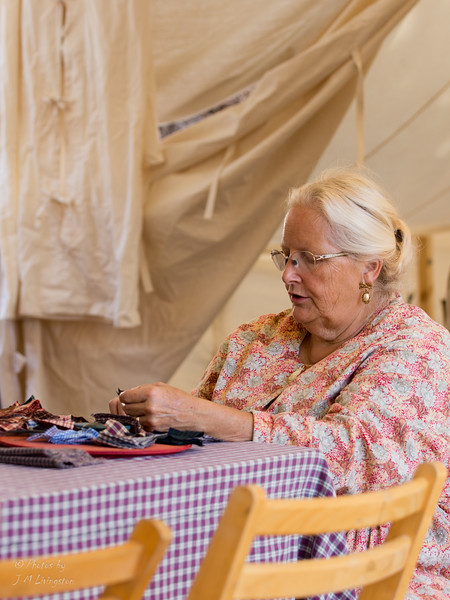 Lady from the Georgia Relief Agency quilting