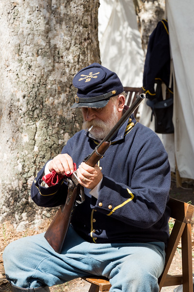 Soldier caring for his musket