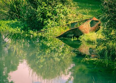 8-11-18: Half sunk boat