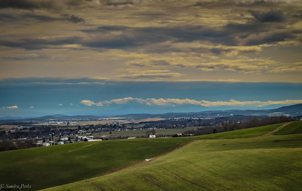 2-27-21: Green fields and wild clouds  from Mole Hill looking east
